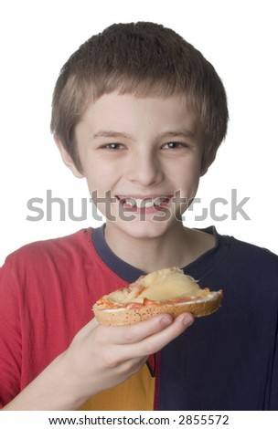 young boy eating sandwich - stock photo