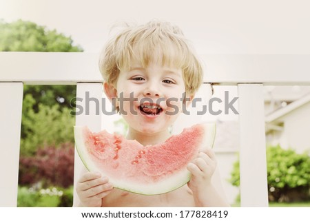 Young boy eating watermelon - stock photo