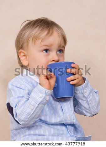 Young boy (eighteen months) drinking juice - stock photo