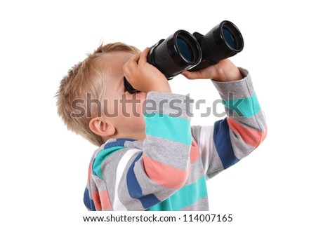 Young boy explorer searching with binoculars - stock photo