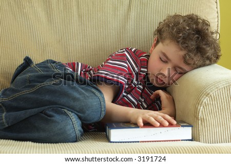 Young boy fell asleep during reading