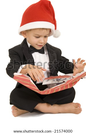 Young boy finishing up opening present and seeing his new toy. Isolated on white. - stock photo