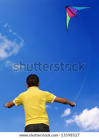 Young boy flying a kite - stock photo