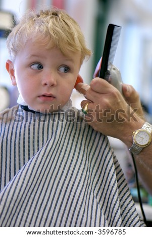 Young boy getting a haircut - stock photo
