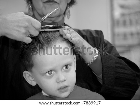 Young Boy Getting Hair Cut at Barber - stock photo