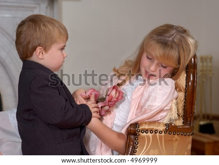 Young boy giving flowers to sleeping girl