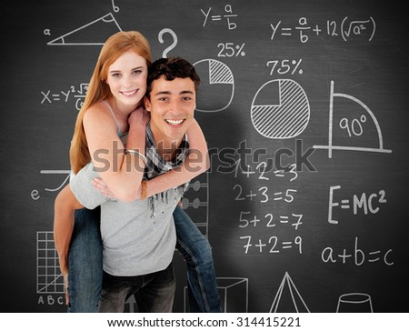 Young boy giving his friend piggyback ride against black background - stock photo