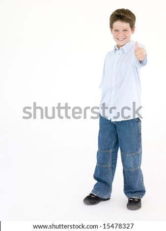 Young boy giving thumbs up smiling - stock photo