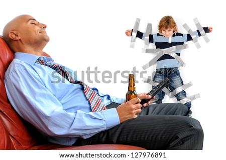 Young boy glued to the wall with duct tape, so daddy can relax and have a beer - stock photo