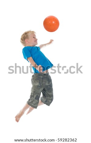 Young boy going to make a header. Will he score? Isolated on a white background. Little movement in arms and legs. - stock photo