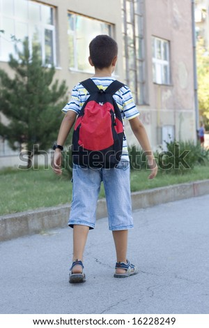 Young Boy Going to School - stock photo