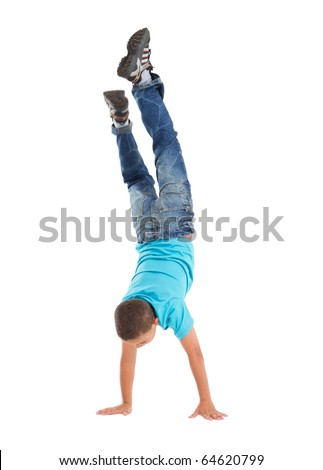 young boy handstand - stock photo