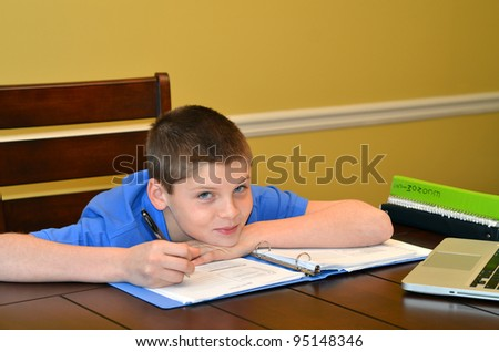 Young boy happy to study his homework - stock photo