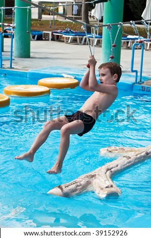 young boy having fun in aquapark, Limassol, Cyprus