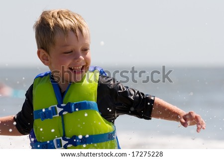 Young boy having fun in the ocean
