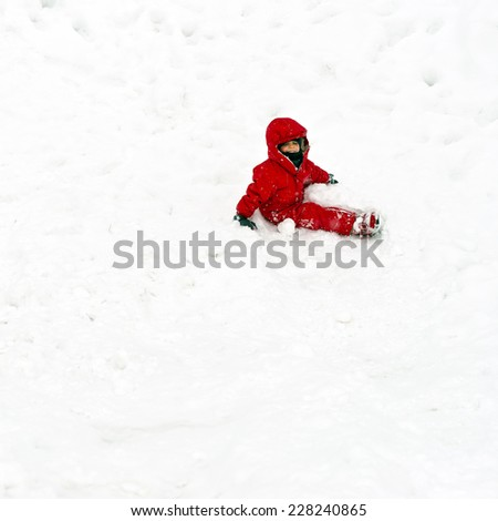 Young boy having fun in the snow.  - stock photo
