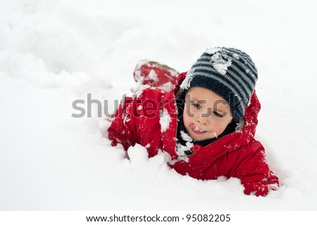 Young boy having fun in the snow.