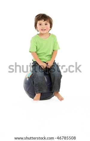 Young Boy Having Fun On Inflatable Hopper