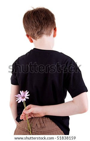 Young boy hiding flowers behind his back, isolated on white background. Studio shot