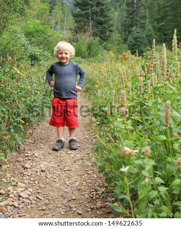 Young boy hiking on a trail in Utah, USA.