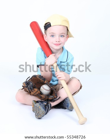 Young boy holding a baseball bat with ball and glove - stock photo