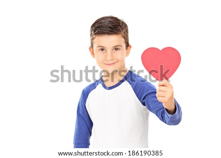 Young boy holding a red heart isolated on white background - stock photo