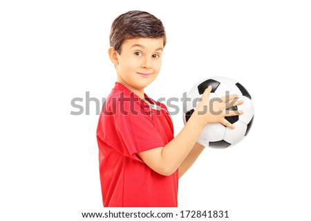 Young boy holding a soccer ball isolated on white background - stock photo