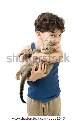 young boy holding and kissing a kitten - stock photo