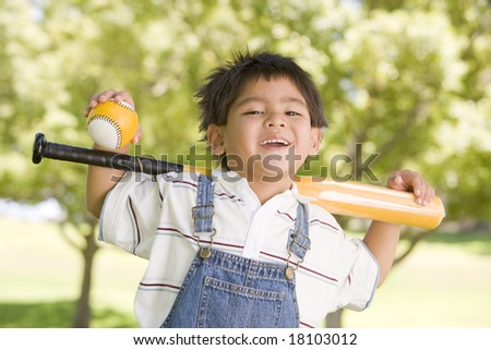 young boy holding baseball bat - stock photo
