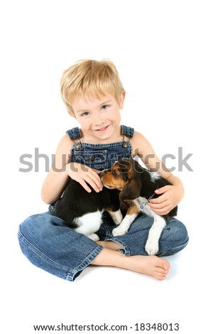 Young boy holding Beagle puppies