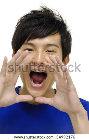 young boy holding hands beside his cheeks and shouts an announcement. - stock photo