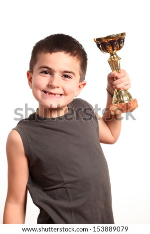 young boy holding his trophy on white background  - stock photo