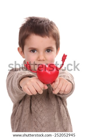 young boy holding red heart - stock photo