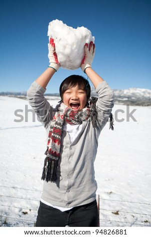 young boy holding snowball