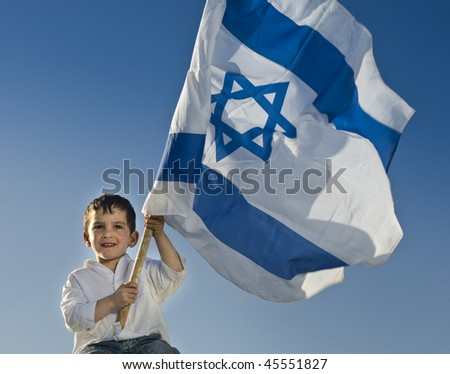 young boy holding the Israeli flag - stock photo
