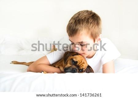 Young Boy Hugging his Dog - stock photo
