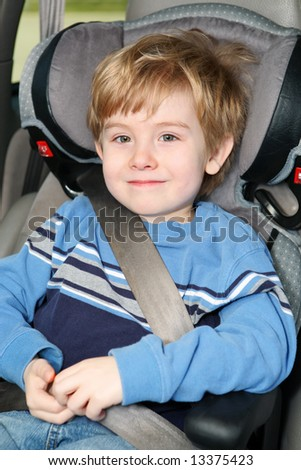 Young boy in a booster seat - stock photo