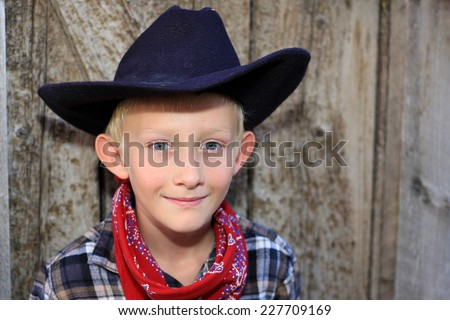 Young boy in a cowboy outfit. - stock photo