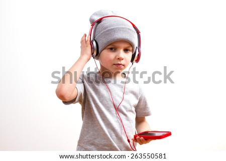 Young boy in a gray hat and headphones - stock photo