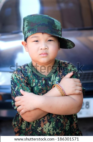 Young boy in a military clothing - stock photo