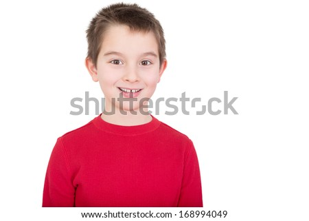 Young boy in a red t-shirt with a happy grin and alert expression, isolated on white - stock photo