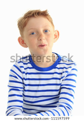 Young boy in a striped shirt smiles at the camera. Vertical shot. Isolated on white. - stock photo
