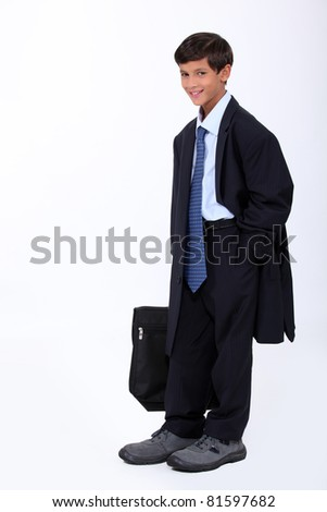 Young boy in an adult business suit - stock photo