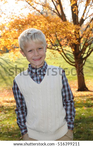 young boy in autumn
