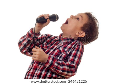 young boy in checkered shirt yelling in microphone - stock photo