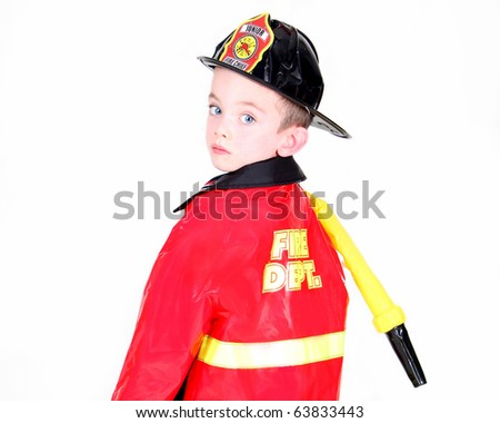Young boy in fireman costume on white background - stock photo