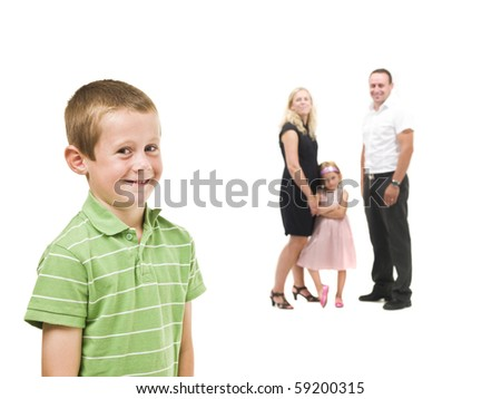 Young boy in front of his family isolated on white background - stock photo