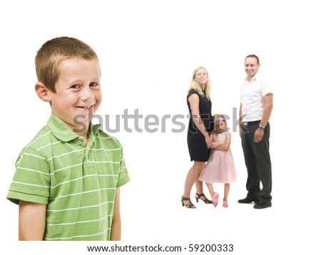 Young boy in front of his family isolated on white background