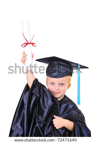 Young boy in graduation dress - stock photo