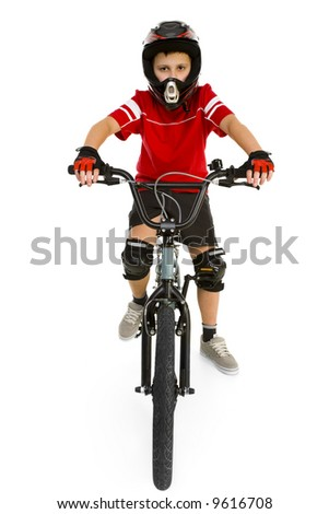 Young boy in helmet and protection kit sitting on BMX and looking at camera. Front view. Isolated on white background. - stock photo